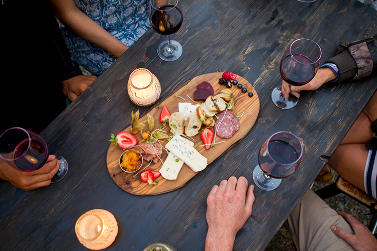 Friends sharing a charcuterie board in Whistler