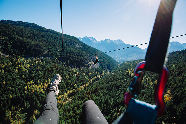 Ziplining by a mountain view in Whistler