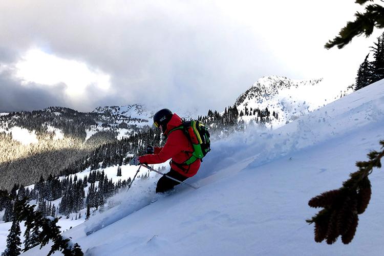Heli-ski touring in Coast Mountain powder conditions