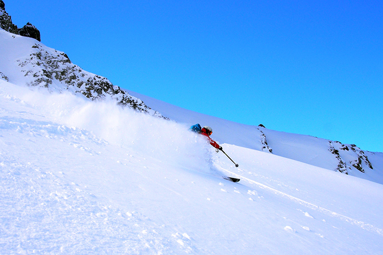 Skiers in powder conditions in Whistler's backcountry