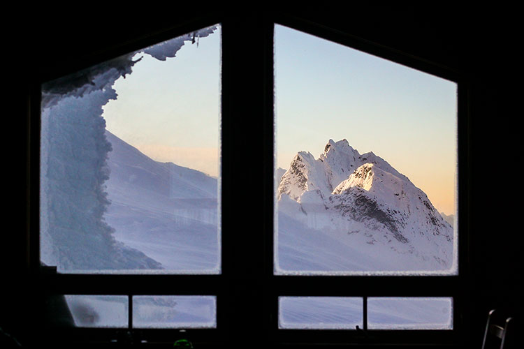 Stunning mountain views out of a window.