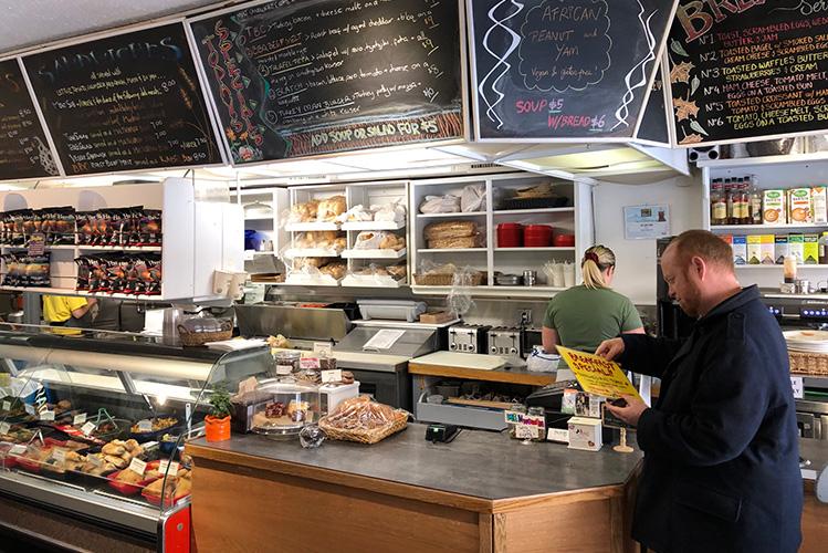 Mayor lookg at the menu at Ingrids in Whistler