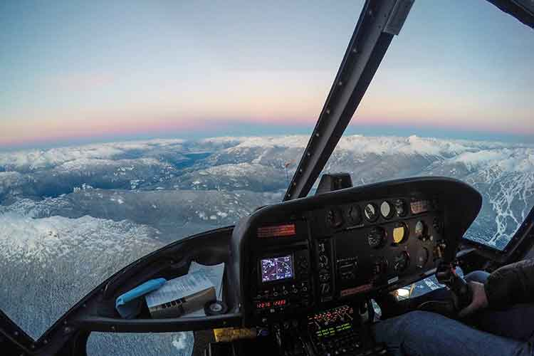 view out the front window of a helicopter at sunset