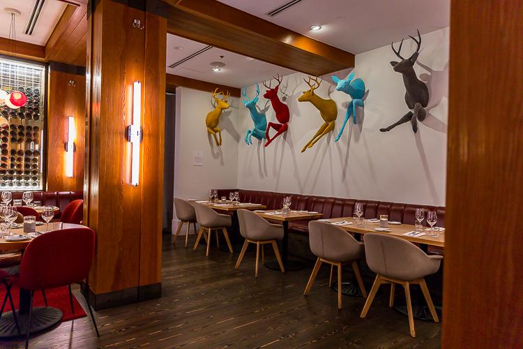 Art work of running deer adorn the walls at the Aura restaurant.