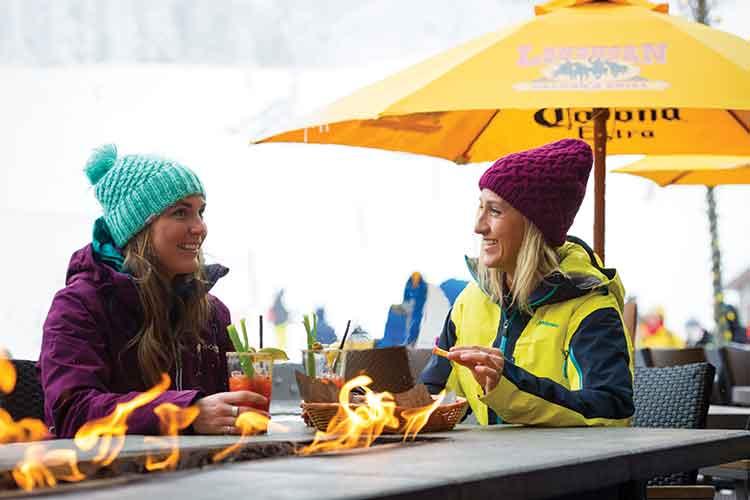 Women enjoying a fireside apres.